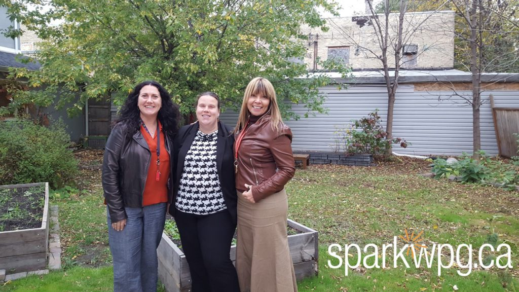 Cynthia (l), Monica, and Lisa pose in the yard that will get a refresh thanks to Monica and HTFC
