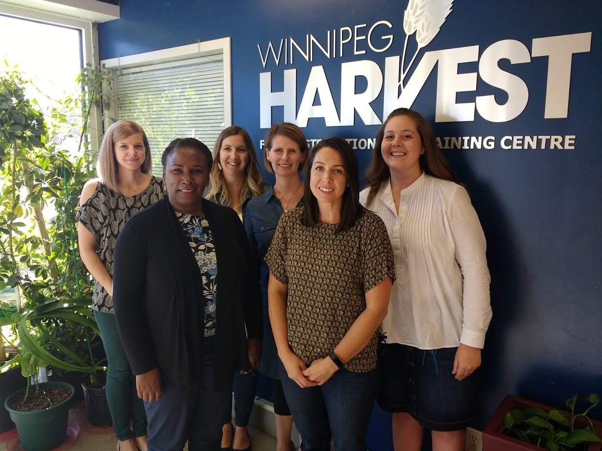 Winnipeg Harvest and the team at S3 at their match meeting